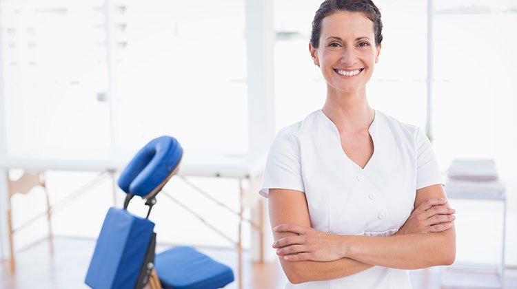 smiling woman in the massage room