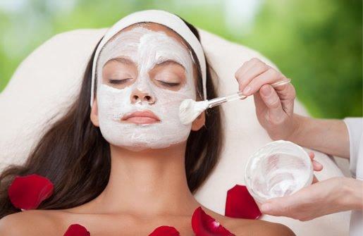 woman getting a facial scrub