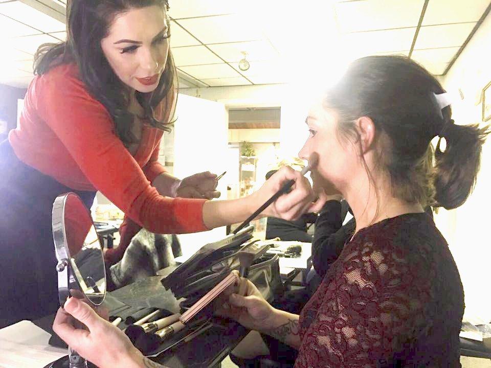 girl doing a make up demonstration