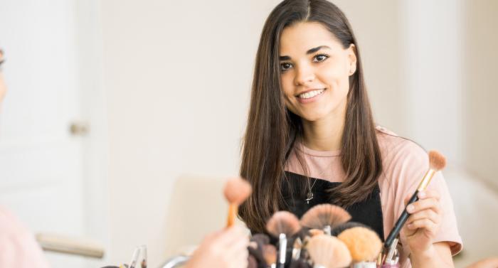 girl holding brush for make up