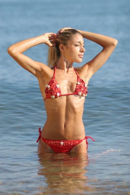 blonde in a two piece bikini on the beach