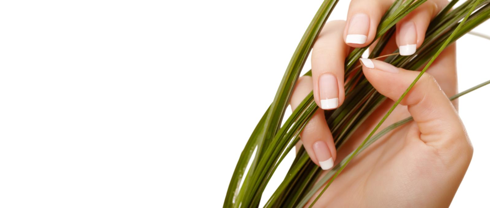 newly polished nail grabbing green grass