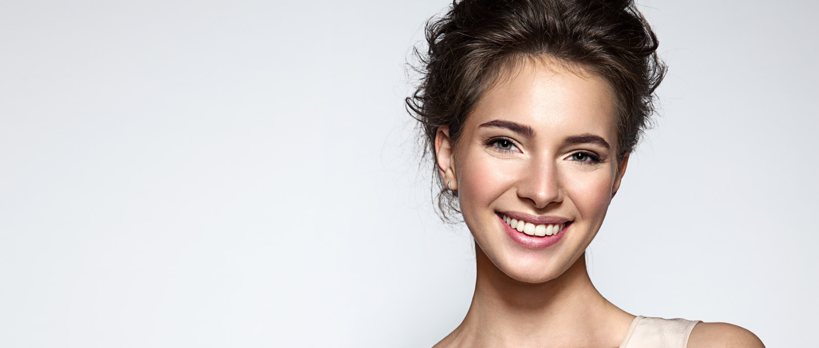 woman smiling with smooth skin and light make up